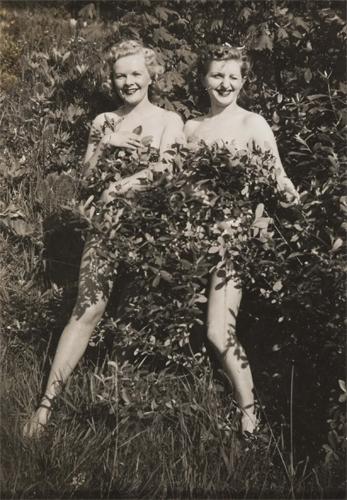 Two nude ladies in bush c1930s image
