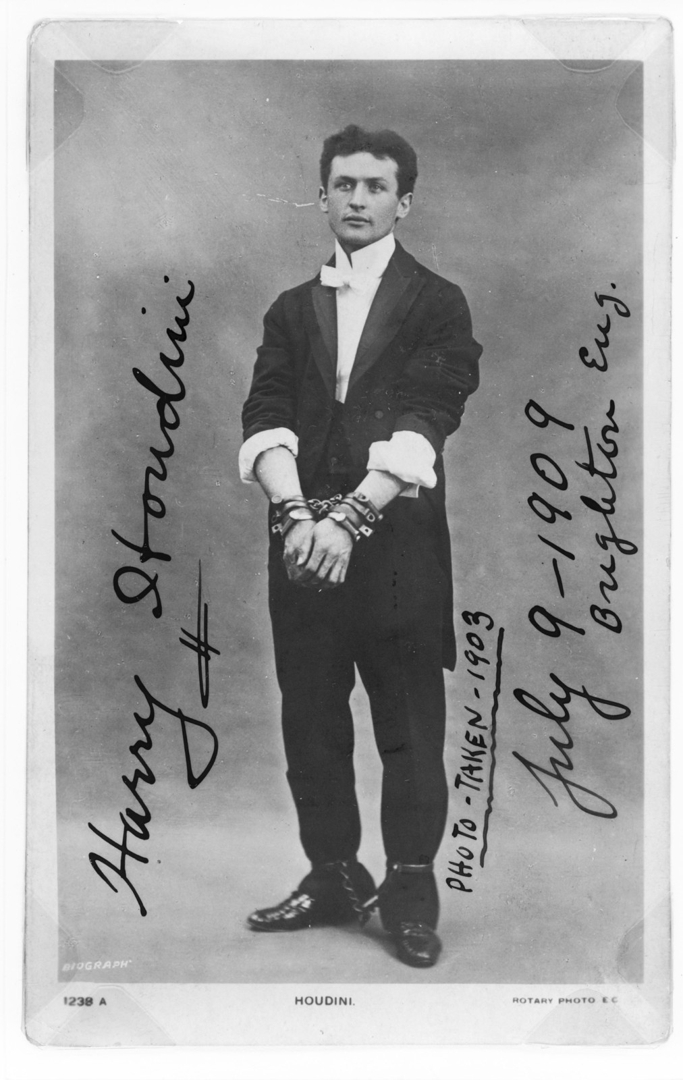 Harry Houdini, full-length portrait, standing, facing front, in chains, 1903 image