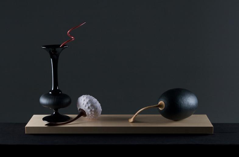 Black scent bottle, Granulare fruit and Olive image