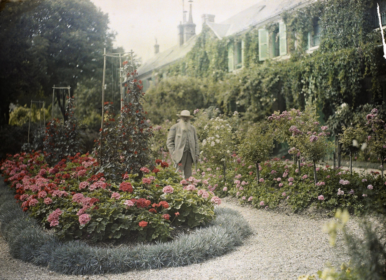 Claude Monet outside his house at Giverny image
