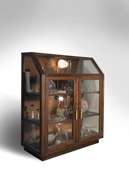 Nadia Mercuri, Wunderkammer 2013. Blown Glass, antique scientific glass, found object, antique cabinet, 125 x 106 x 45 cm. Photograph: Andrew Barcham image
