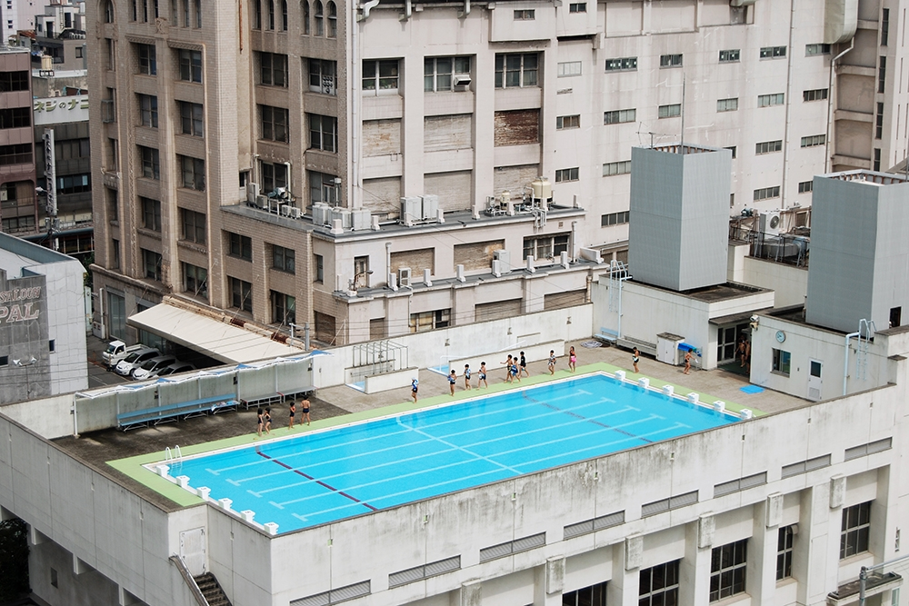 'Children on a rooftop swimming pool in Osaka' image
