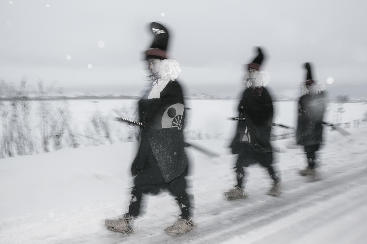 Three Men Walking On A Snowy Road image