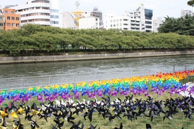 recycled plastics turned into wind-wheels on the banks of the river, osaka image