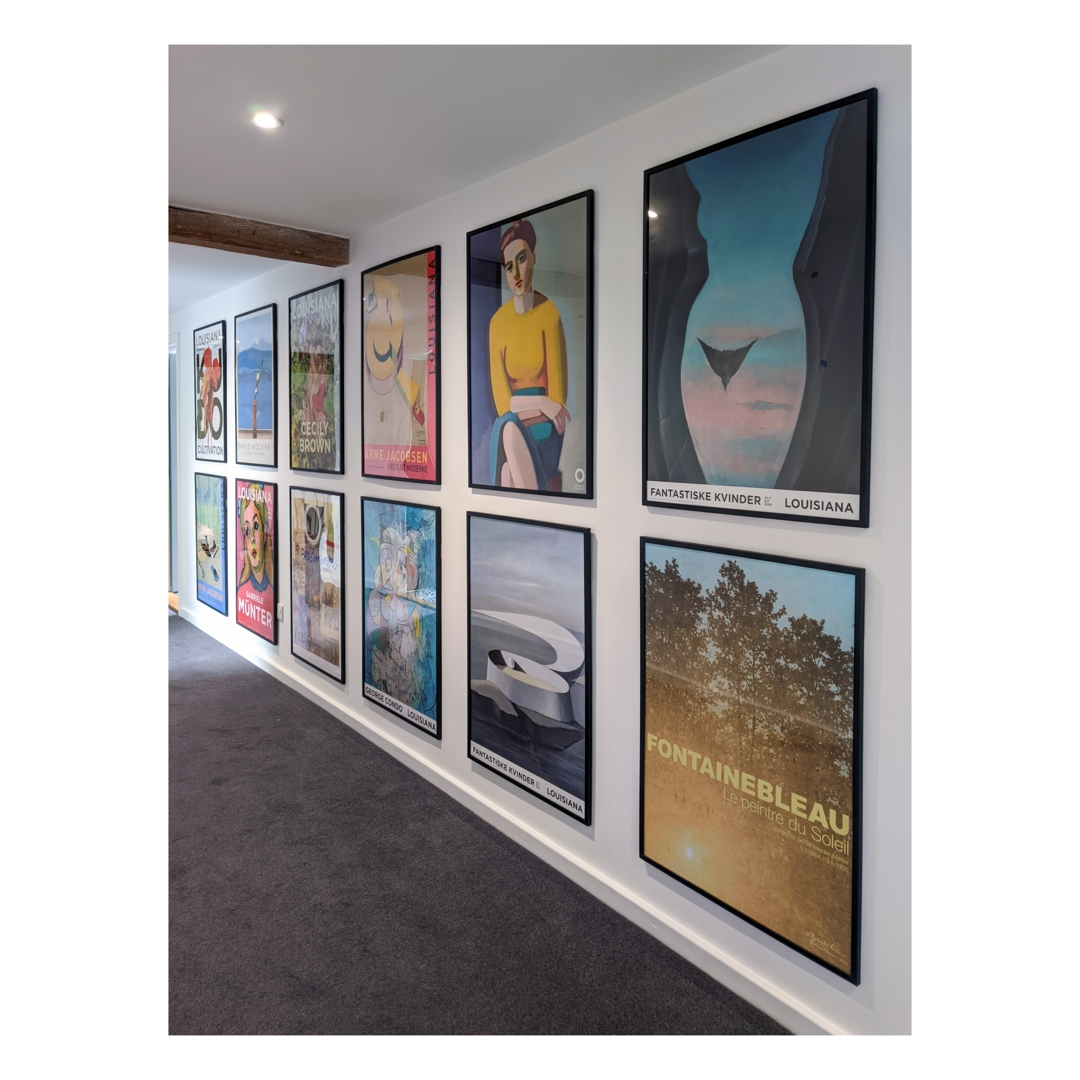 Picture hanging arrangement in hall way image