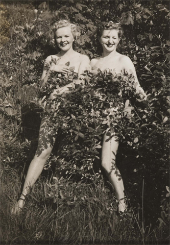 Two nude ladies in bush c1930s image