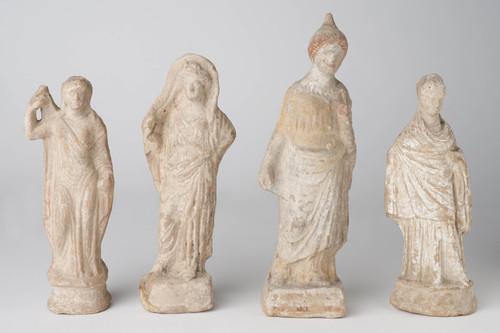 Four terracotta female figurines Hellenistic, 4th century BCE image