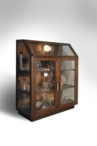 Nadia Mercuri, Wunderkammer 2013. Blown Glass, antique scientific glass, found object, antique cabinet, 125 x 106 x 45 cm. Photograph: Andrew Barcham image