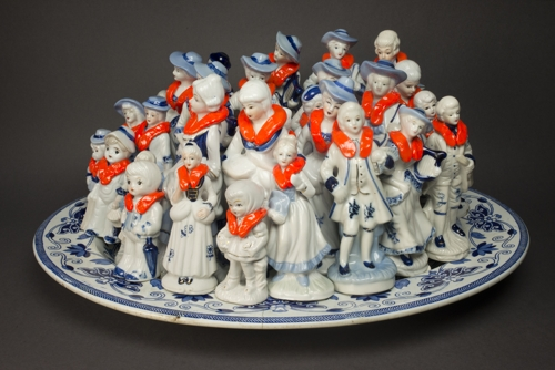 'EuropaEuropa' vintage porcelain blue and white figurines, platter, epoxy putty, orange enamel paint.  dimensions variable  Darebin Art Collection  Courtesy of the artist image