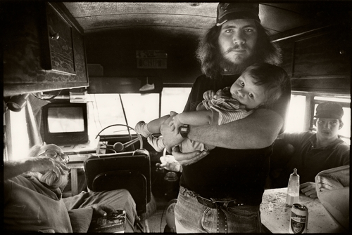 Father and Son, Family of 9 Living in a School Bus image